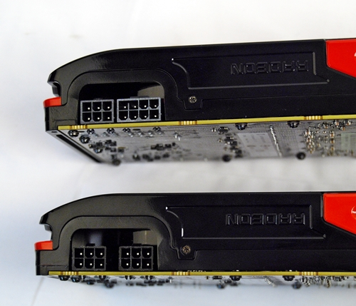 At the top, Radeon HD 7970 has one 6-pin PCIe power connector and an 8-pin one. Its younger brother, Radeon HD 7950, has a pair of 6-pin PCIe power connectors.