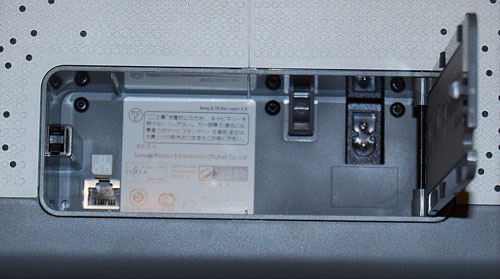 The compartment also houses the power adapter connector (top right) along with an Ethernet port (bottom left) that is required for initial setup.