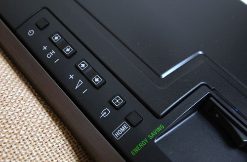 Controls on the HX925 include buttons for channel selection, volume, source inputs, and a Home button which brings up the revamped NUX user interface. A large on/off rocker switch is located just below the row of hardware buttons.