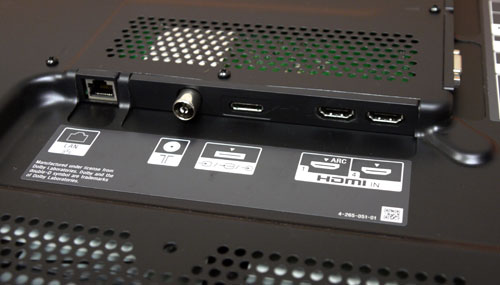 The bottom flank (on the rear panel) features a LAN port, a RF connector, a proprietary connector for composite and component inputs (hence a breakout cable), and two HDMI ports. ARC (Audio Return Channel) is integrated with the HDMI 1 inlet.