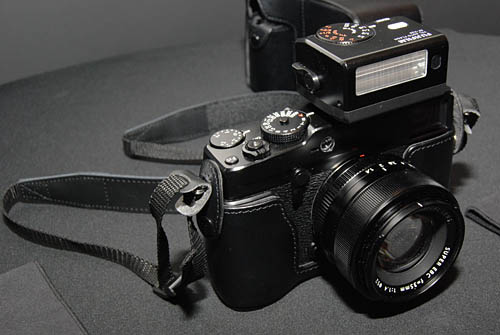 The shoe mount flash EF-X20, seen here mounted on the X-Pro1, will be sold separately. The X-Pro1 does not come with a built-in flash.