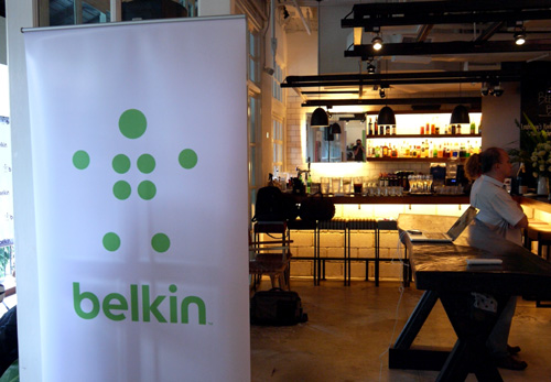 Belkin showcased their new corporate logo today, as shown on the banner gracing the cosy interior of Hummerstons. Belkin's rebranding is also partially inspired by the return of their founder, Chet Pipkin, who's now President and CEO of the networking and connectivity devices company.