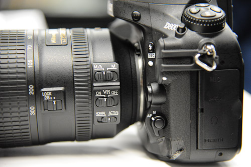 The D7000's AF control switch is replicated here (the unmarked round button on the AF/M lever near the lens).