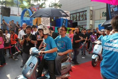 Following the dancers were riders on customized Vespas who rode in with passengers twirling umbrellas