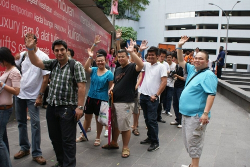 The happy faces of customers queuing up in line for a brand new Nokia Lumia 800