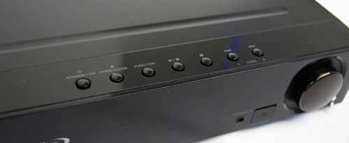 Standard buttons on the top right are used to power on the device and control playback.