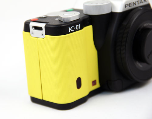 The bright yellow ribbed rubber design gives the K-01 a different look and feel from other cameras.