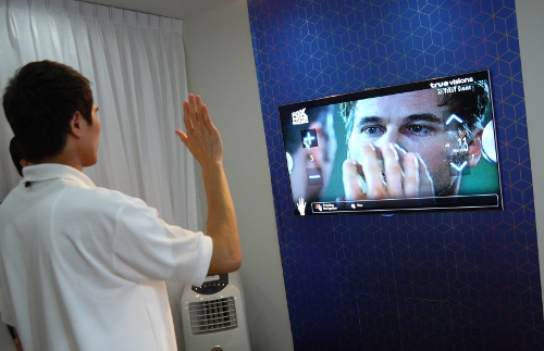 A Samsung spokesman showed us how you may control the TV's channels or volume levels simply by moving your hands. To activate the onscreen function, clench your fist and the TV ought to register the command.