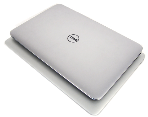 The Dell XPS 13 sitting on a 13-inch MacBook Air. It's more compact...
