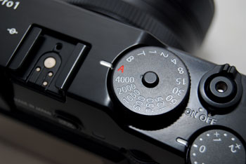 To activate Shutter Priority mode, simply turn the dial to set a shutter speed value. To make it automatic, set to 'A'.