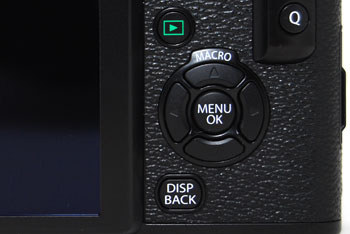 Compared to the X100, the d-pad has been split into more comfortable individual buttons, and the scroll wheel has been removed.