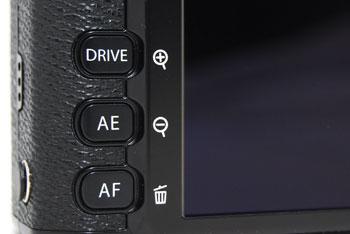 The AF button on the bottom left only opens up AF point selection, it does not let you toggle between AF modes.