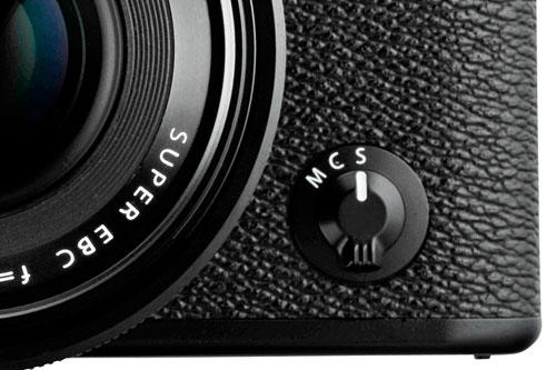 The focus switch on the front of the camera lets you switch between automatic ('S' for Single AF, 'C' for Continuous AF) and manual focus ('M').