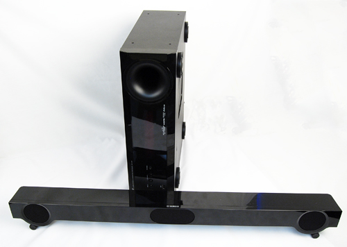 The Yamaha YHT-S401 comprises of a receiver (the vertical unit in this photo) and a horizontal front speaker. A Blu-ray player is not included as part of the package.