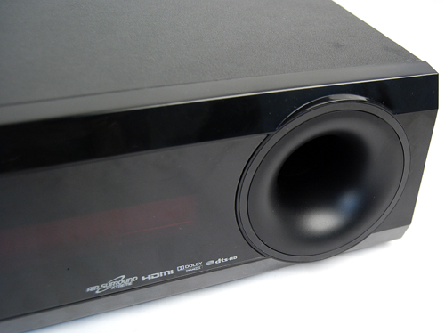 The right hand side gives notice that the subwoofer is built into the unit.