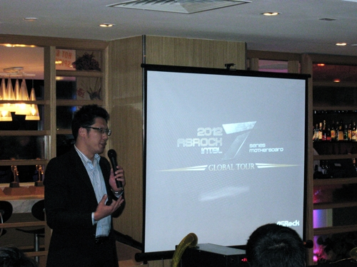 Mr Chris Lee, Deputy Director of ASRock's Marketing Departments addressing the crowd of power users and enthusiasts, introducing the 7-series motherboards to the enraptured crowd.
