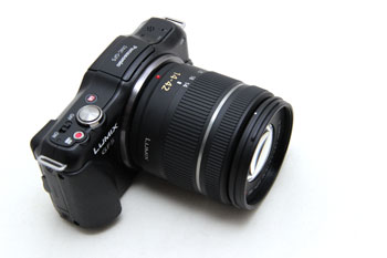 The entire package is larger with the standard 14-42mm lens.