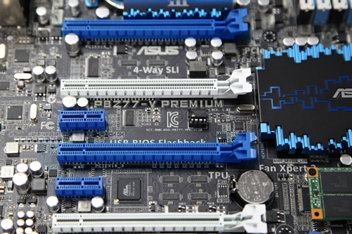 Upon scrutiny, the board seems to feature a PLX controller to increase the number of PCIe lanes. We are unable to confirm the exact make of this controller with the provided images but it may be the PLX PEX 8608 which offers eight additional PCIe 2.0 (5GT/s) lanes to the board.