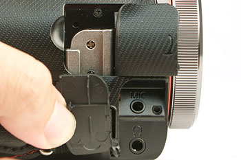 On the side of the grip belt, you'll find more ports, such as the accessory shoe and the external microphone and headphone terminals shown here.