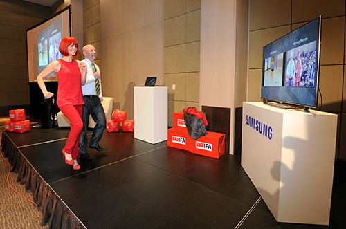 Samsung was at the IFA GPC to showcase its latest ES8000 Smart TV (here you see Miss IFA with Michael Zoeller from Samsung Europe demonstrating the fitness feature of the TV). The TV allows users to interact with the TV via voice, gestures and facial recognition, and comes with Smart Evolution, which allows a user to upgrade the hardware of the TV over a period of 5 years via a card slot at the back.