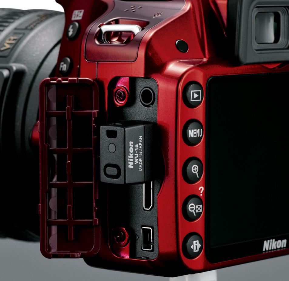 Nikon D3200 with optional WU-1a Wi-Fi dongle. (image Source: Nikon)