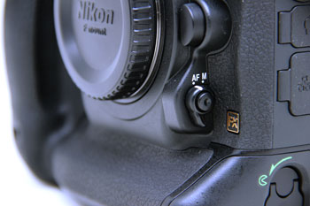 The D4 gains the focus-mode selector first seen on the D7000.