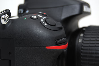 The shutter release button sits at a lower, more comfortable angle.