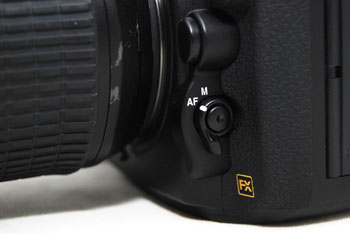 The D800 gains the focus-mode selector used on the D4 and D7000.