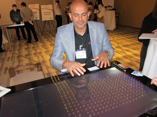 Somanna Palacanda, Director of Microsoft Surface Marketing, gave us a quick demo of how the SUR40 works.