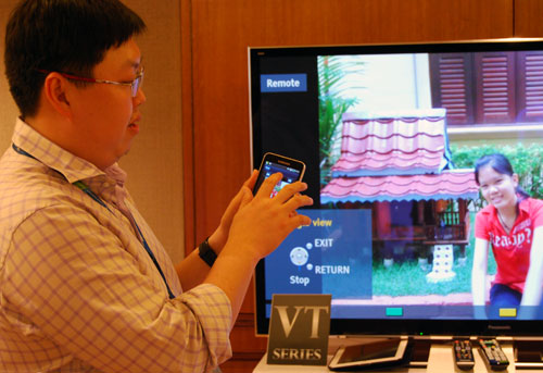 Panasonic spokesman, Will Yu, demonstrating the finer aspects of the improved Viera Remote app which transforms your smartphone or tablet into a touch-based remote with tap-and-flick features.