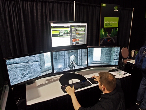 The four-monitor setup is powered by a pair of GeForce GTX 680 cards in SLI configuration. The game on display is Skyrim with its settings set at maximum to tax the pair of graphics cards. You can also note the 'accessory' display complimenting the main gameplay screens, though we're not totally sold of its usefulness.