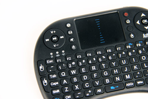 "At the bottom left of the touch pad is a button which functions as the left mouse button, or rather, the ""select"" button."