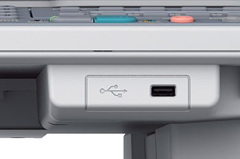 You can print from or scan to USB memory via the USB port at the front.