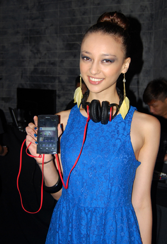 This pretty lady is holding up the new Sony Walkman NWZ-Z1050, an Android-based portable music player.