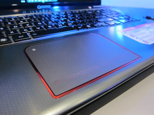 The red border along the gigantic trackpad doesn't light up or does anything fancy, but it does add to the overall aesthetics. The LED light at the top left corner lights up when the trackpad is disabled.
