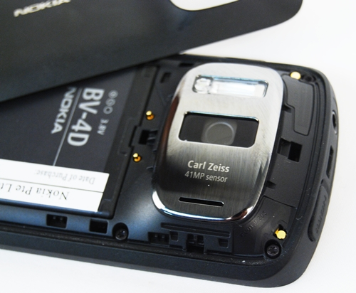 Having a larger sensor than the usual cameraphone means, more space required and a bigger body. As you can see from the back, the big camera bulge is flanked on the right by a large Xenon flash. Users have to remove the battery to insert your microSD or microSIM cards.