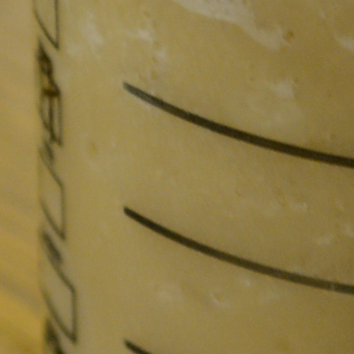 The D800 shows that noise is well controlled, and the image is still sharp at the area of focus (the lines on the cup)