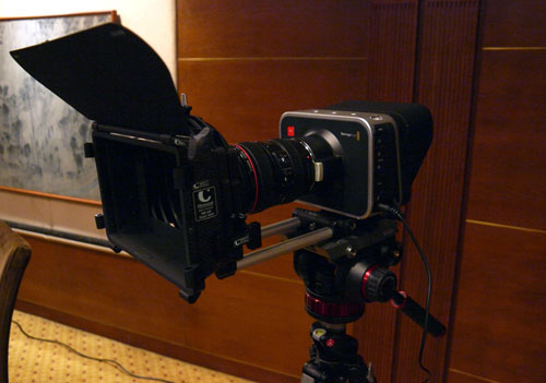 Blackmagic Design's Cinema Camera is displayed here in full production gear; complete with lenses, lens hood, and a tripod. Also note that Blackmagic will be retailing the Cinema Camera without any stock lens.