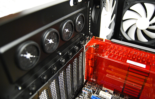 Installation of expansion bay devices such as graphics cards require you to undo thumbscrews. Seen are are also the four grommets for liquid-cooling setups.