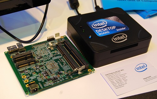 Here's the PCB of the compact palm-sized PC, its enclosure and a name card for comparison.