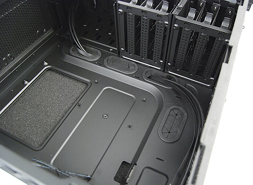 The motherboard tray has numerous cutoffs for cable management.