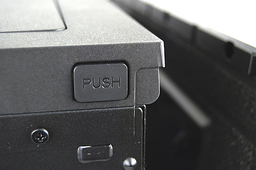 Side panels can be easily removed using this one push button system - one push releases the side panels. It's a very elegant and functional alternative to boring old thumbscrews.