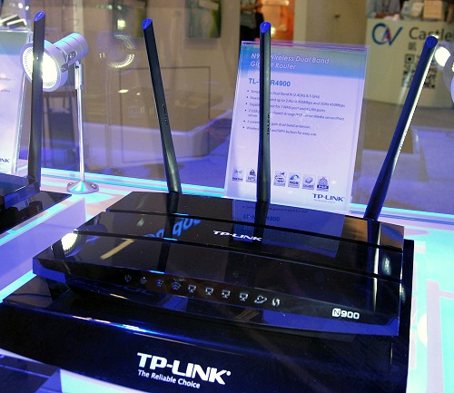 Resembling a dark and sleek flying saucer, this is TP-Link's TL-WDR4900, a Wireless 802.11n dual-band Gigabit router.