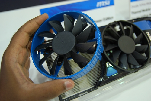The additional cooling fan is fitted with the blue mounting bracket.