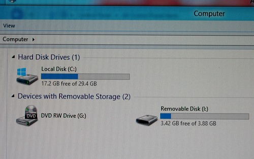 Windows To Go actually disables all of the host's internal hard drives by default. As seen here, only the WTG device running off a 32GB thumb drive and the host system's 4GB thumb drive are visible.