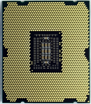 Pictured here is the Intel Core i7-3960X CPU, with its contact pads, that is compatible with a LGA2011 CPU socket. The Intel Core i7-3970X processor will come in the same package.