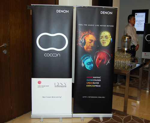 As proclaimed by the banners at the door, Denon is going mainstream with the introduction of docking speakers as well as end-user headphones.