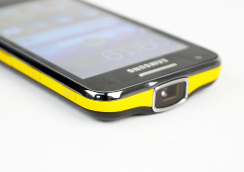 "The splash of yellow does add a little life to an otherwise serious ""business"" smartphone. Note the huge projector lens on the top."