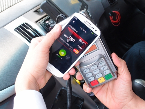 Soon, smartphone users will be able to use their devices to pay for services like taxi transport via NFC.