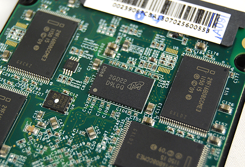 Flipping the PCB over, we see another eight NAND chips and an additional 512MB DDR3-800 cache chip from Micron Technology.